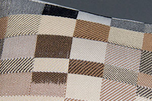 Double weave jacquard woven with partially painted warp