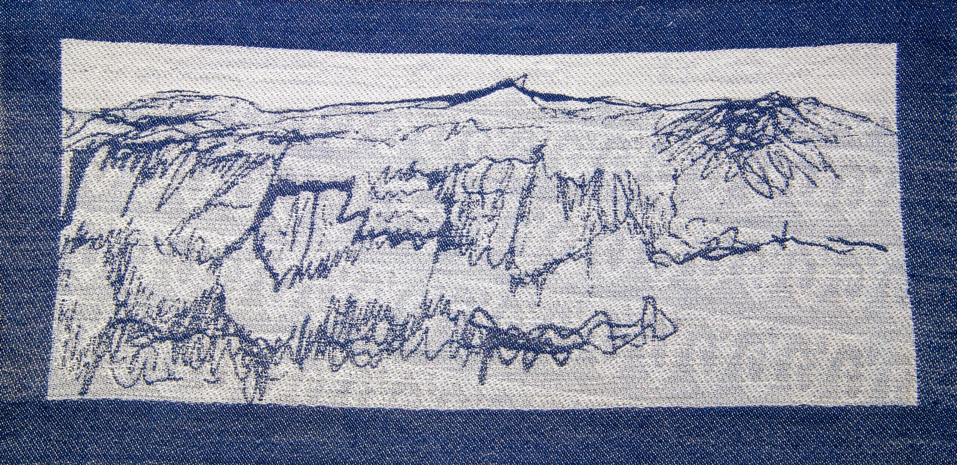 woven image of snowy hills