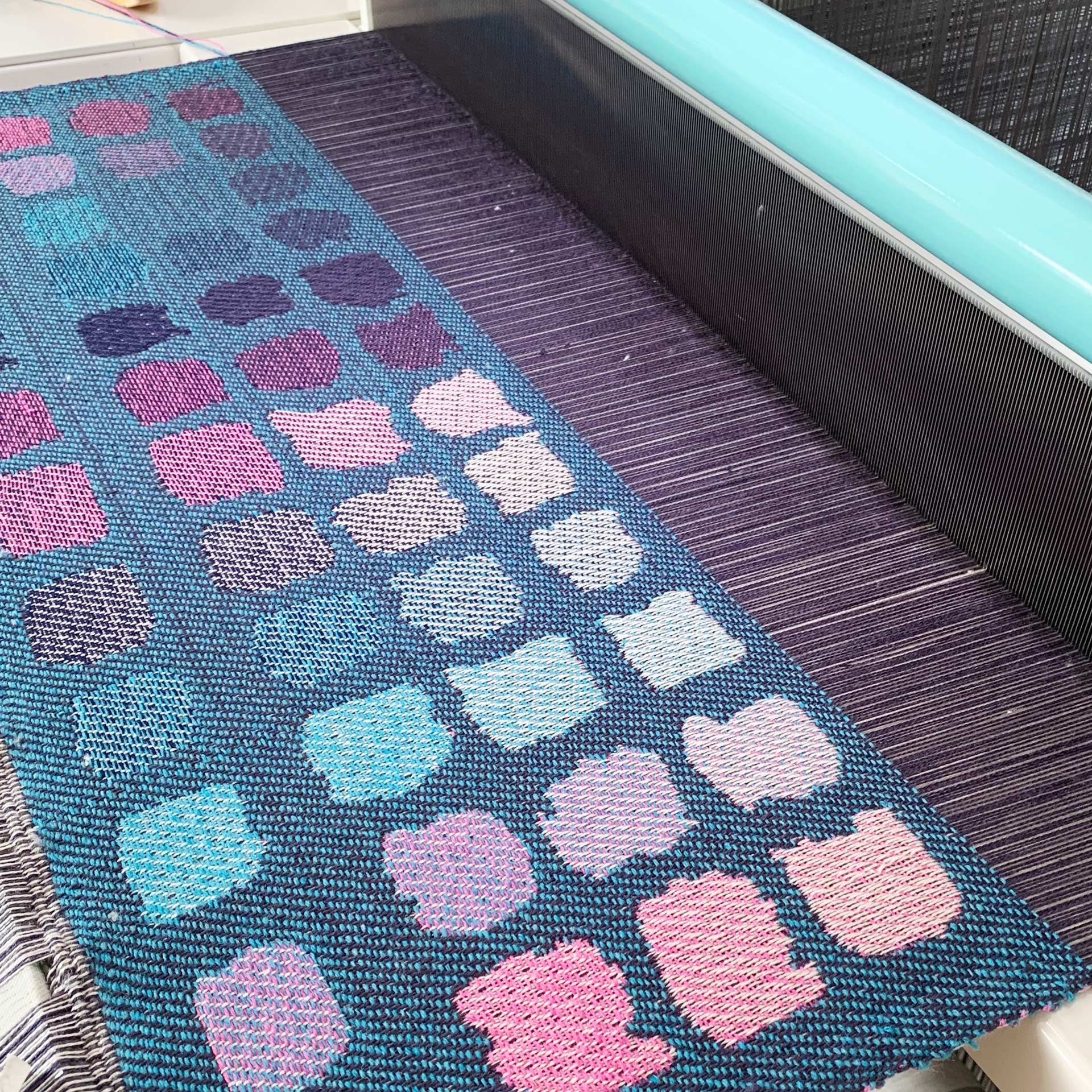 fabric being woven